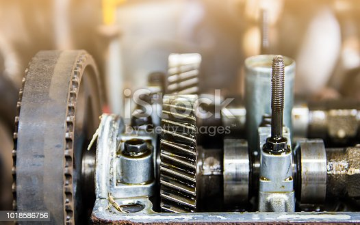 istock Repairing of engine closeup of camshaft and valves 1018586756