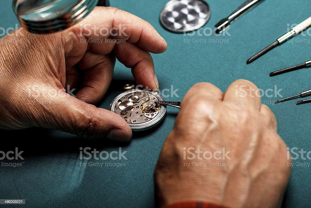 Repairing old pocket watch stock photo