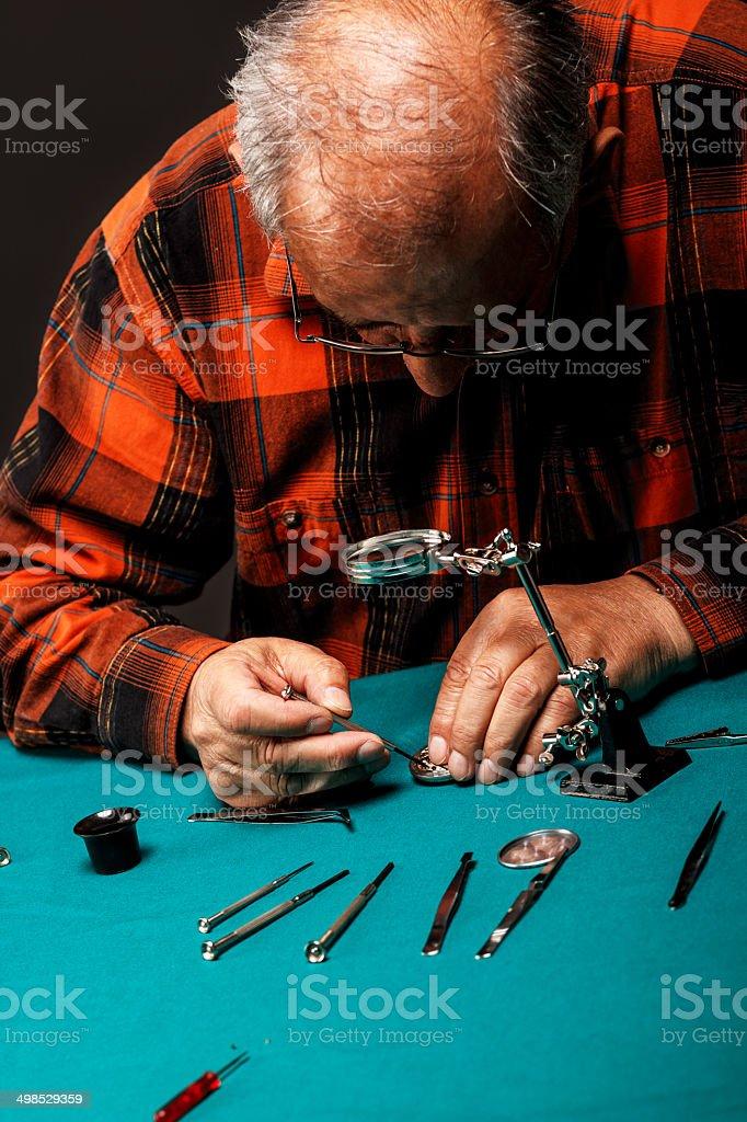 Repairing old pocket watch royalty-free stock photo