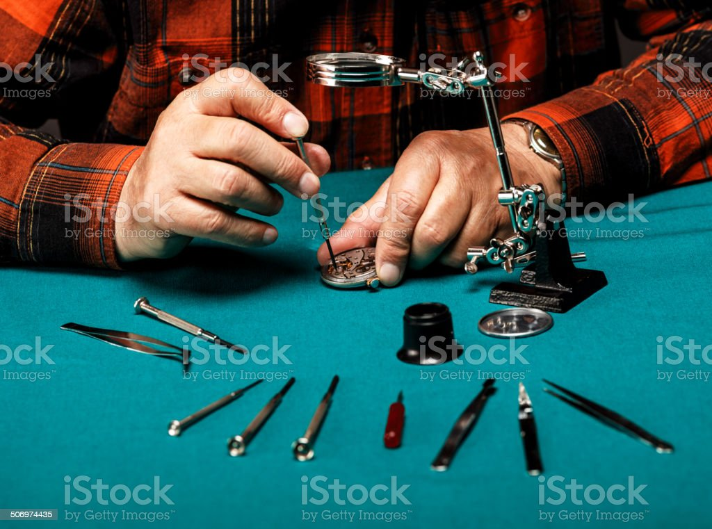 Repairing old pocket watch royalty-free stock photo