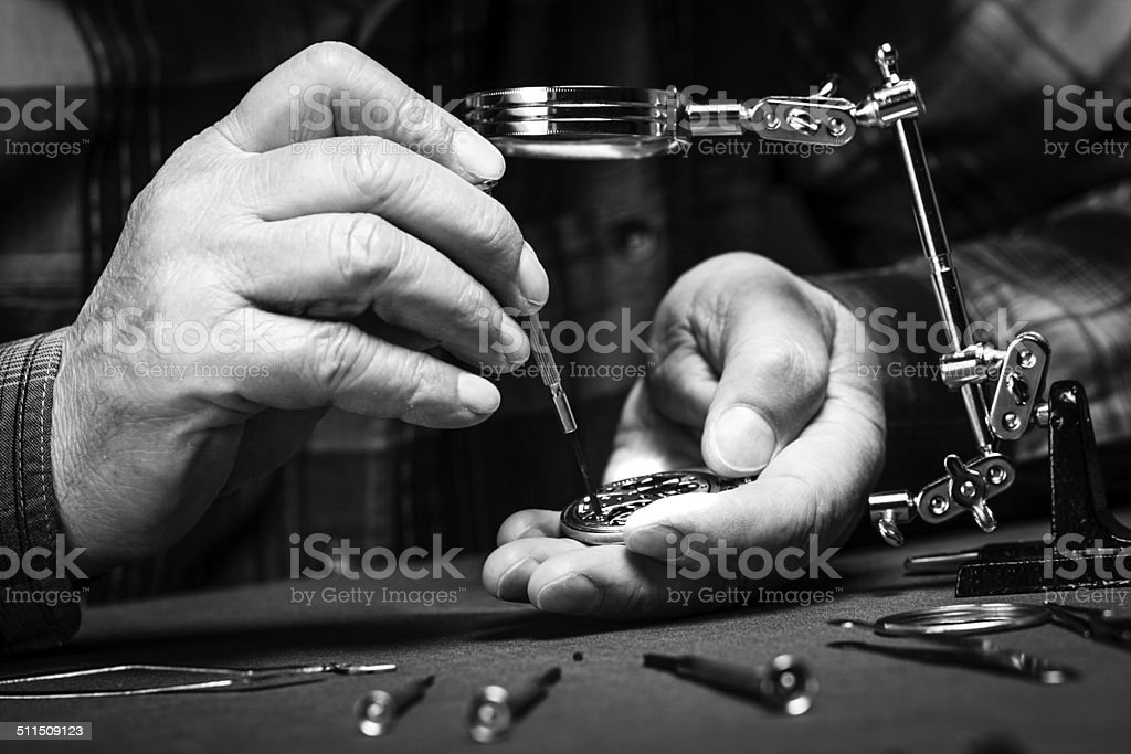 Repairing old pocket watch stock photo