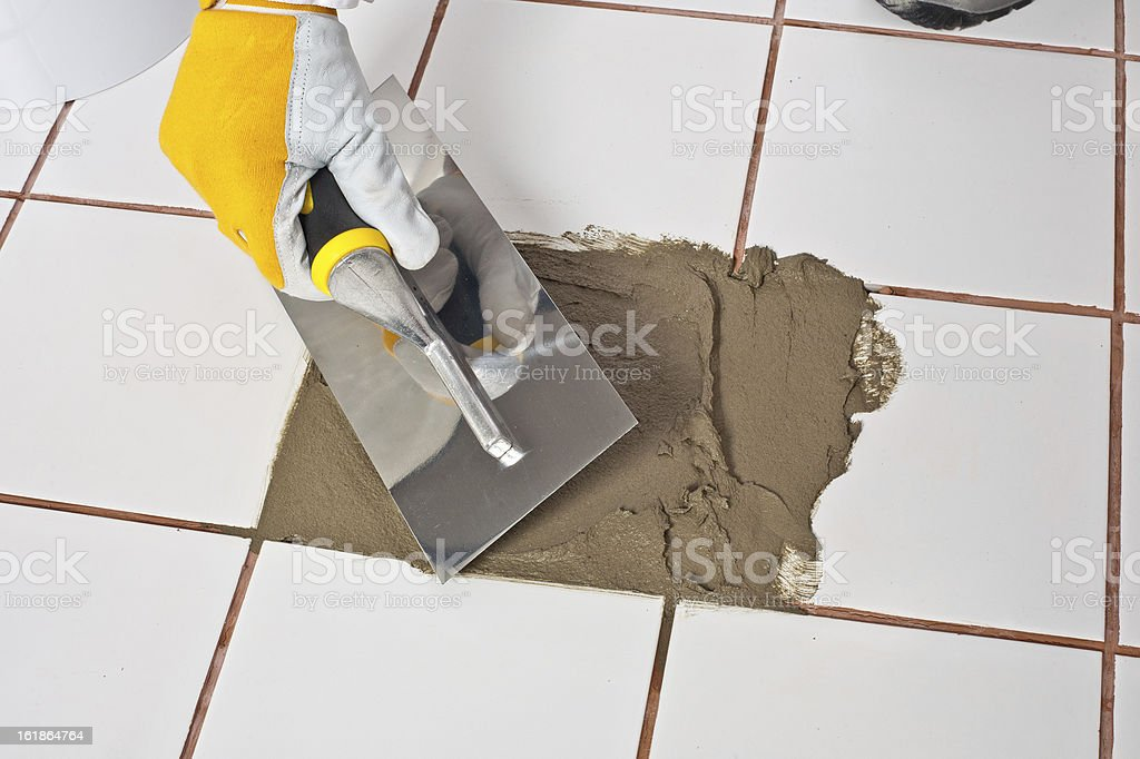 Repairing old tiles with tile adhesive royalty-free stock photo