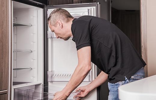 istock Repairing RV Refrigerator 1181642491