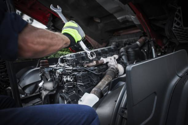 Repairing Semi Truck Caucasian Truck Mechanic Repairing Semi Truck Engine. repairman stock pictures, royalty-free photos & images