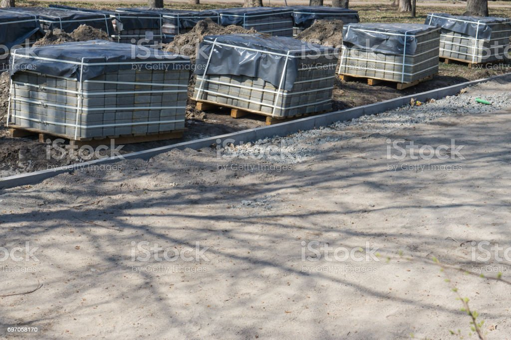 Repairing sidewalk in the park with stone blocks. road paving reconstruction. stock photo