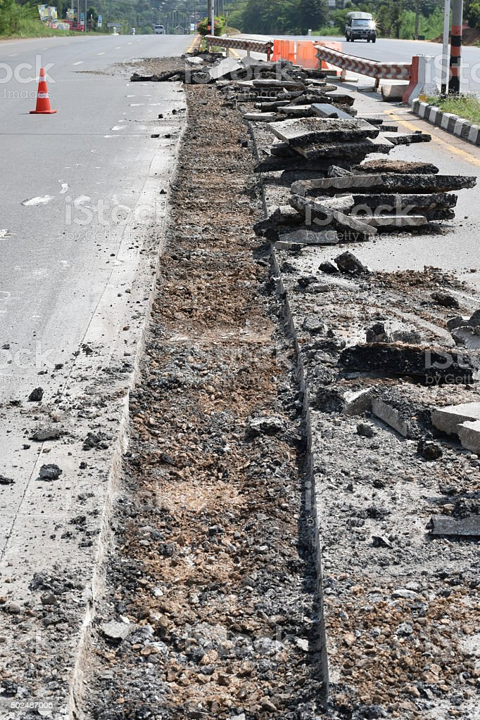 Repairing the asphalt pavement on the road. stock photo