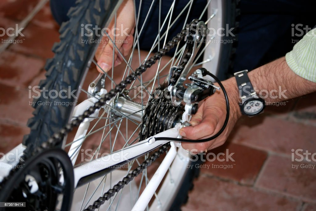 Repairing the bicycle stock photo