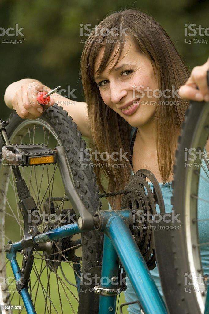 repairing the bike royalty-free stock photo