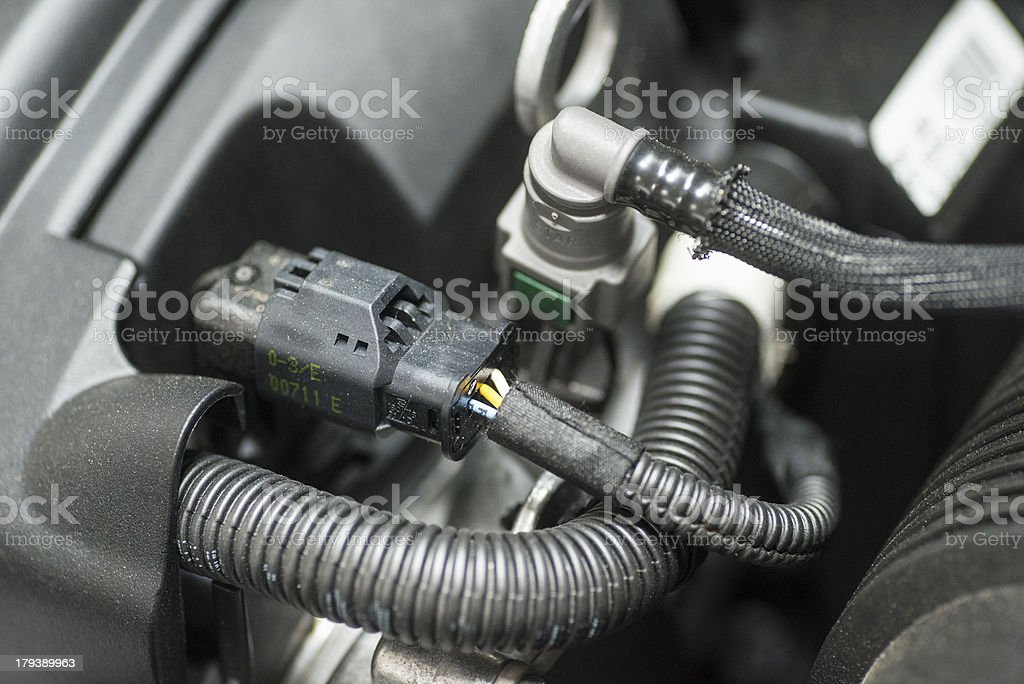 repairing the car electonix hose stock photo