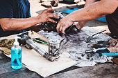 istock Repairing the car power steering gearbox. 1216745943