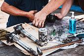 istock Repairing the car power steering gearbox. 1217354590