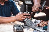 istock Repairing the car power steering gearbox. 1217354636