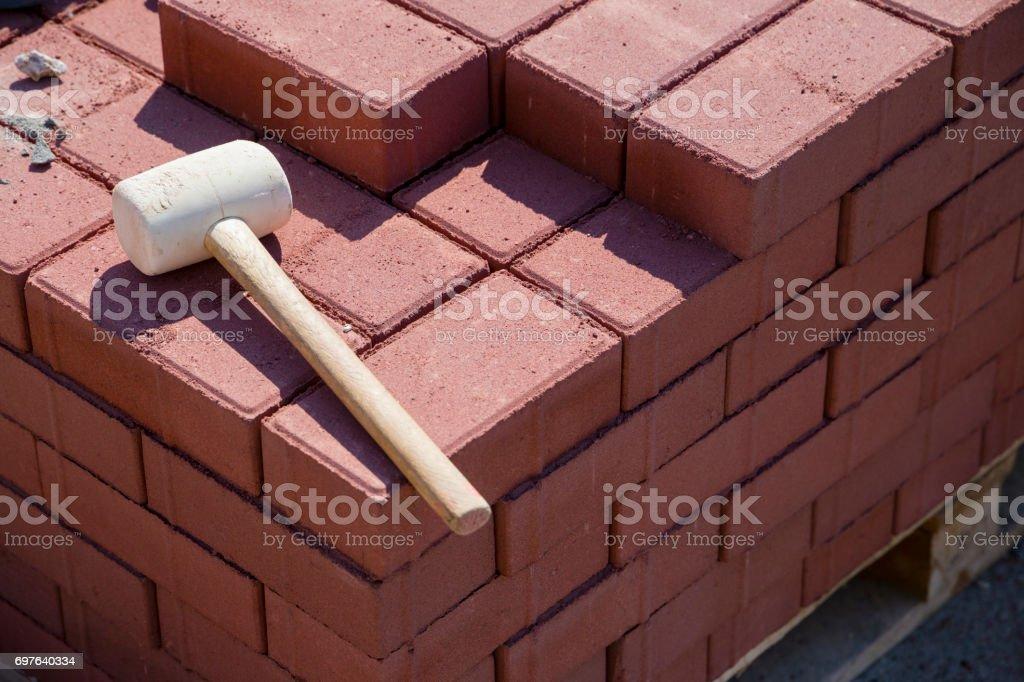 repairing the sidewalk in the city (hammer and bricks) stock photo