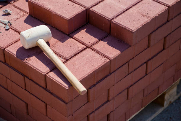 repairing the sidewalk in the city (hammer and bricks) stock photo
