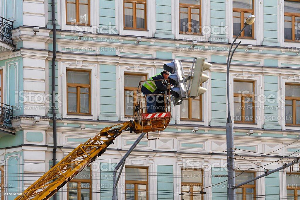 Repairing the traffic light stock photo