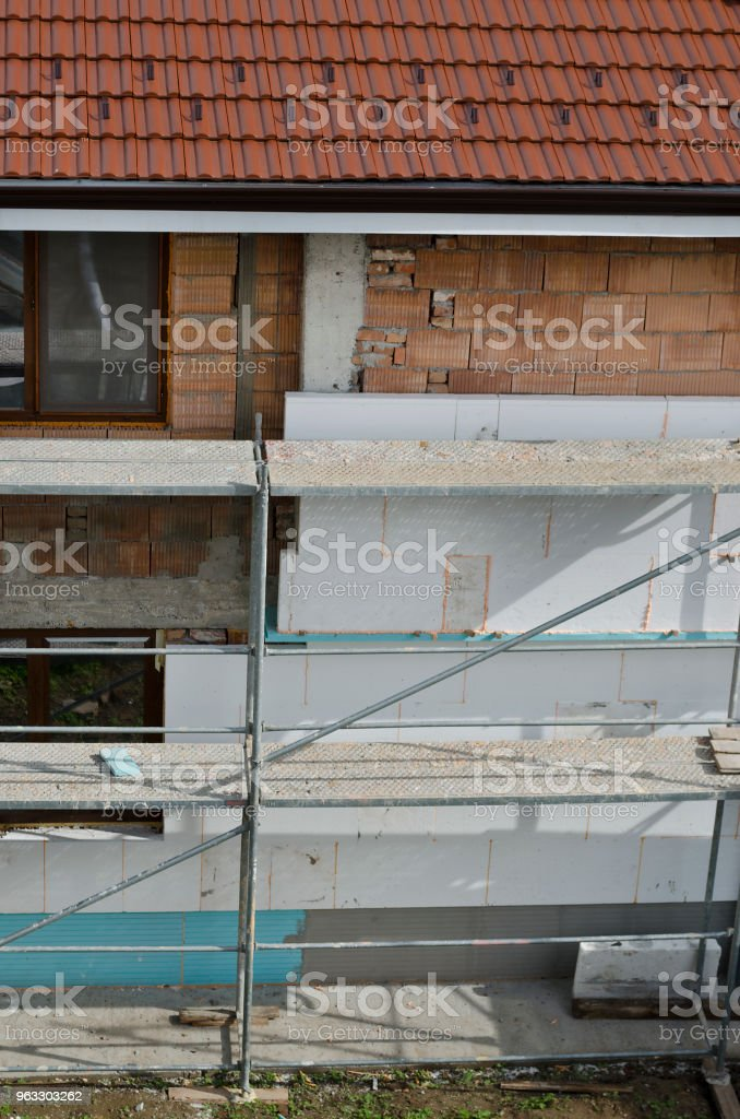 Repairing the walls and putting an insulation stock photo