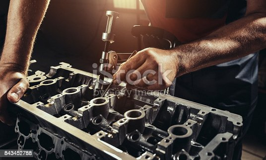 Repairing V10 engine in auto repair shop