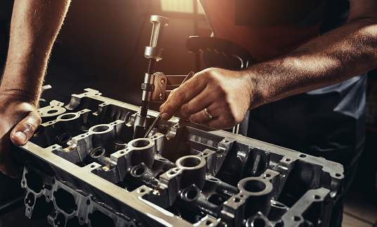 istock Repairing V10 engine in auto repair shop 843452788