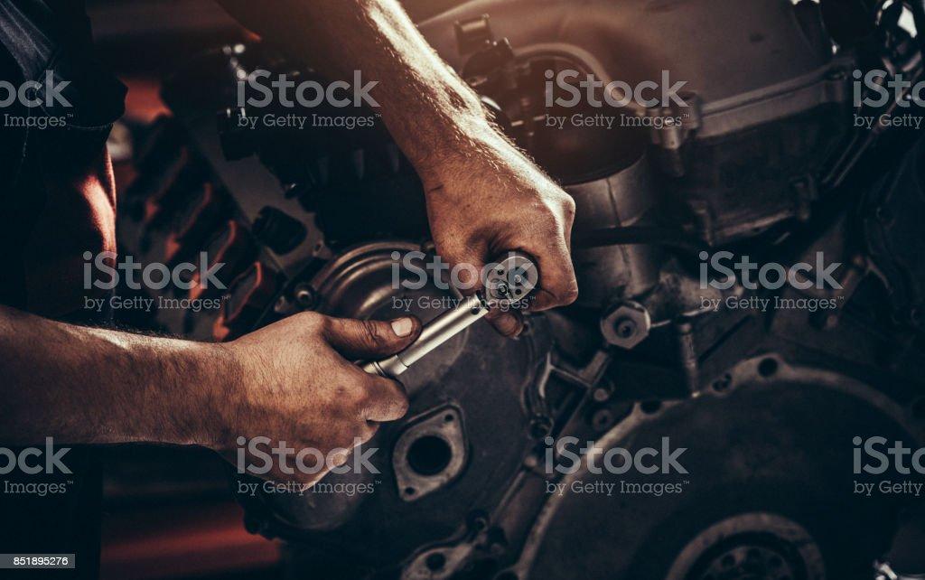 Repairing V10 engine in auto repair shop stock photo