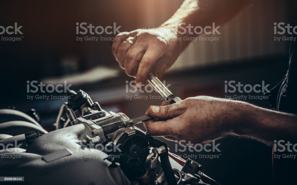 Repairing V10 engine in auto repair shop stock photo