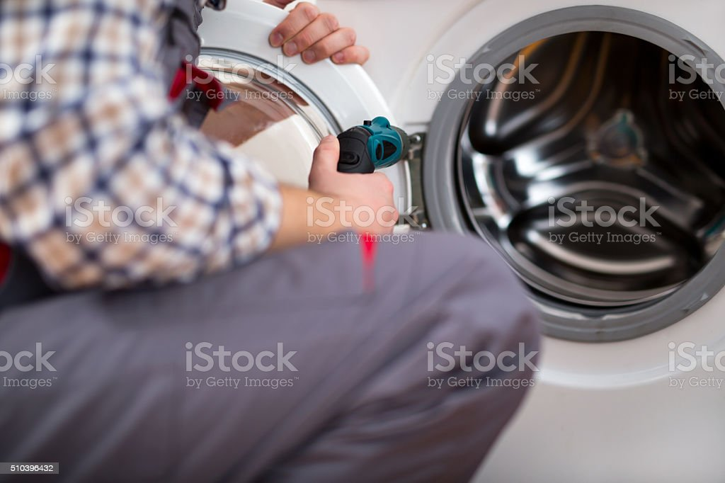 Repairing Washing Machine stock photo