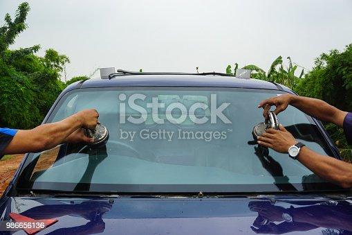 istock repairing windshield replace windscreen wiper tools fix crack broken front window glass car vehicle services by Glazier. Maintenance repair, replace windshield, windscreen car wiper concept. 986656136