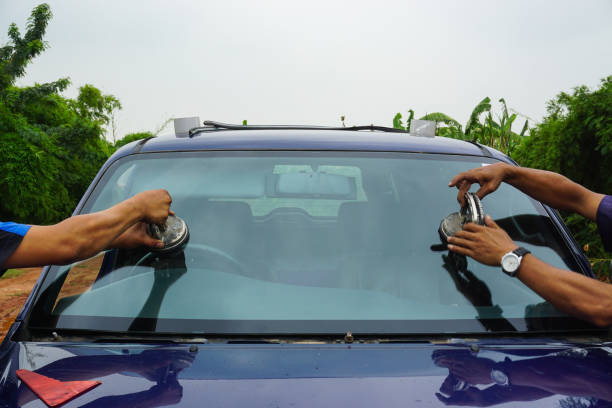 repairing windshield replace windscreen wiper tools fix crack broken front window glass car vehicle services by Glazier. Maintenance repair, replace windshield, windscreen car wiper concept. repairing windshield replace windscreen wiper tools fix crack broken front window glass car vehicle services by Glazier. Maintenance repair, replace windshield, windscreen car wiper concept. replacement stock pictures, royalty-free photos & images
