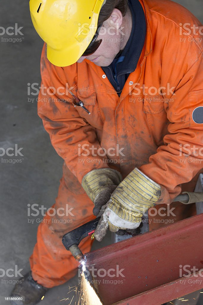 Repairman and mechanic at work with his equipment. royalty-free stock photo