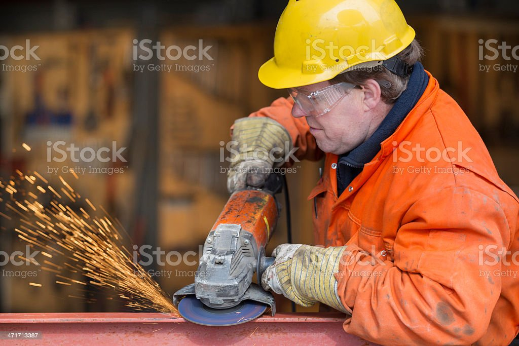 Repairman and mechanic at work with his equipment. If you want more images with a construction worker (with tools) please click here. Built Structure Stock Photo