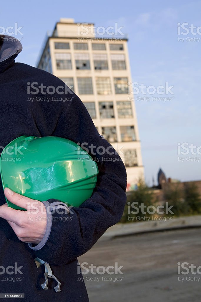 Repairman and mechanic at work with his helmet. royalty-free stock photo
