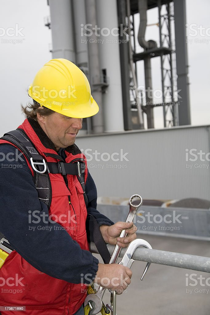 Repairman and mechanic at work with his tools. royalty-free stock photo