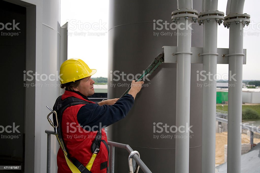 Repairman and mechanic at work with his tools. stock photo