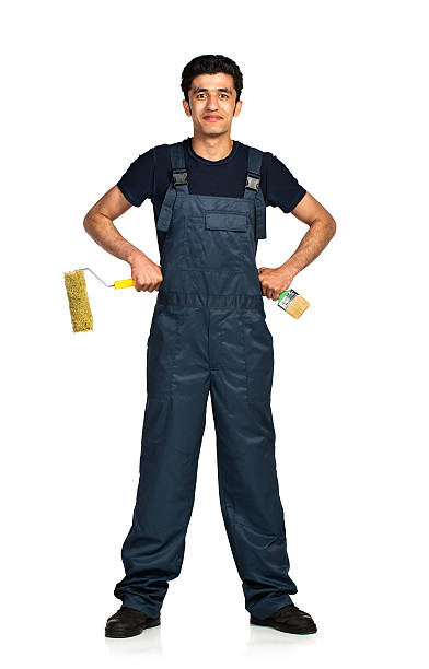 Repairman Arab nationality in the construction overalls on a white Repairman Arab nationality in the construction overalls on a white background with reflection migrant worker stock pictures, royalty-free photos & images
