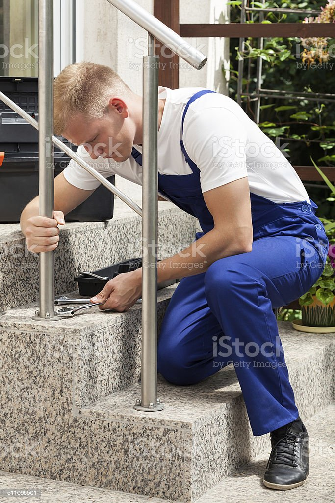 Repairman at work stock photo