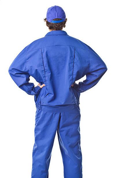 Repairman back portrait with uniform. Repairman back portrait. bib overalls stock pictures, royalty-free photos & images