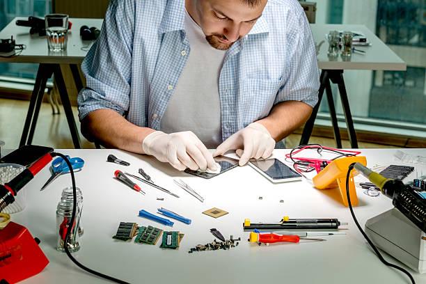 Repairman Cleaning mobile phone stock photo