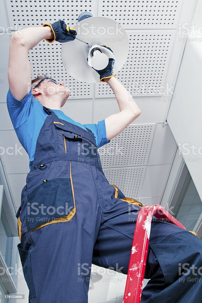 Repairman fixing broken lamp stock photo