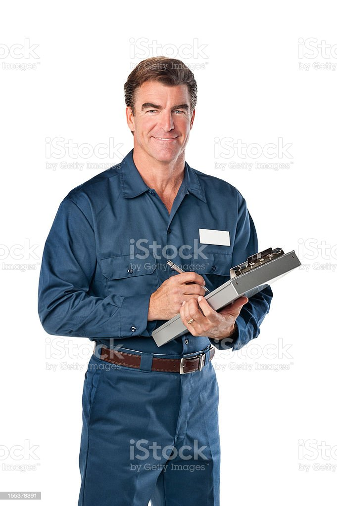 Repairman in blue uniform with clipboard stock photo