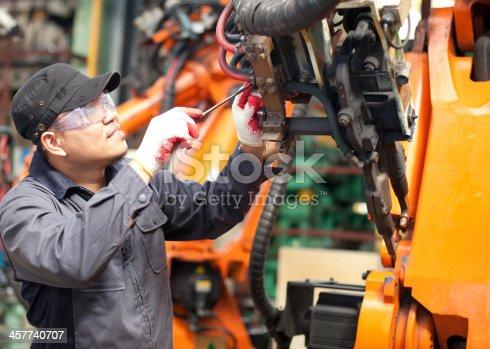 istock Repairman in factory 457740707