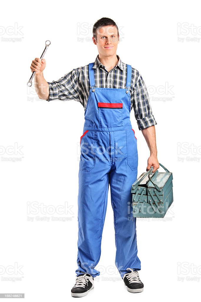 Repairman in overall holding a wrench and toolbox stock photo