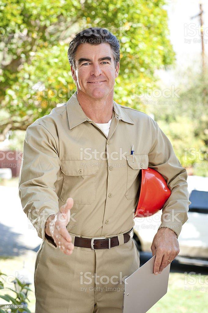 Repairman In Uniform & Hard Hat royalty-free stock photo