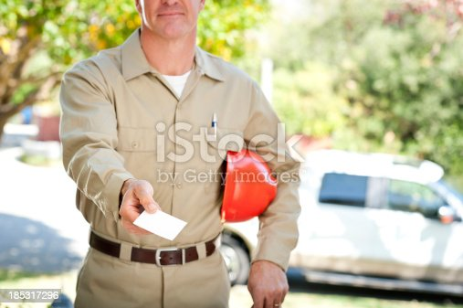 istock Repairman In Uniform & Hard Hat 185317296