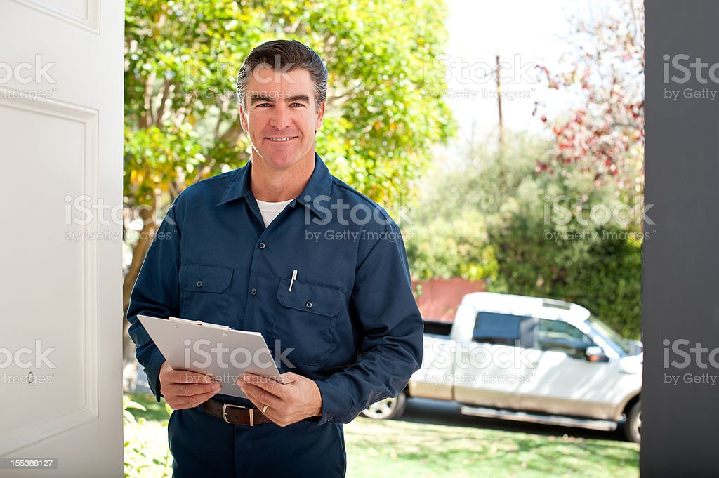 Repairman In Uniform stock photo