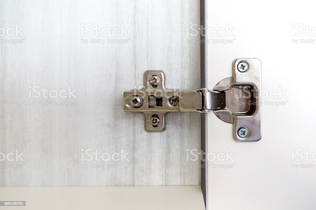 Repairman Install Cabinet Hinge Stock Photo - Download Image