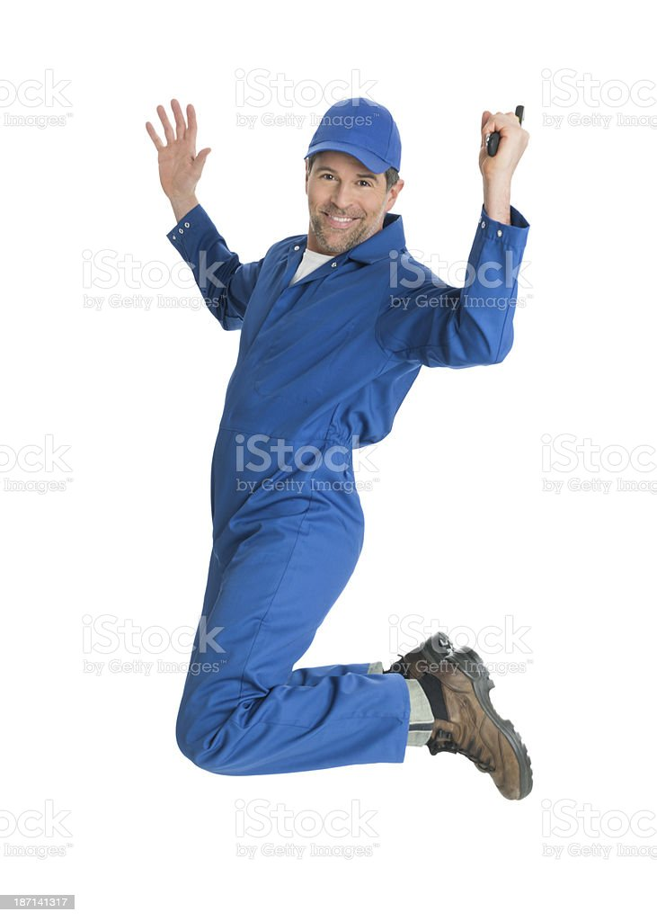 Repairman Jumping Full length portrait of mature repairman holding wrench jumping against white background 40-49 Years Stock Photo