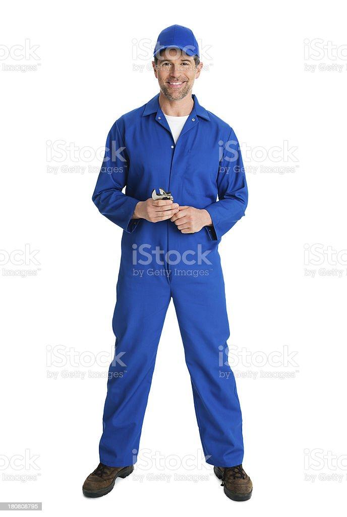 Repairman Mechanic With Wrench stock photo
