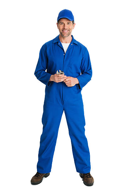 Repairman Mechanic With Wrench Full length portrait of matue repairman mechanic with wrench standing against white background. bib overalls stock pictures, royalty-free photos & images