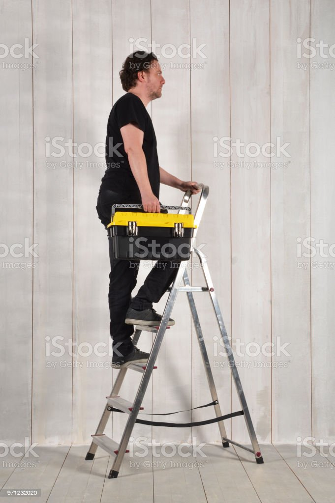 Astonishing Repairman On Ladder With Tool Box Stock Photo Download Machost Co Dining Chair Design Ideas Machostcouk