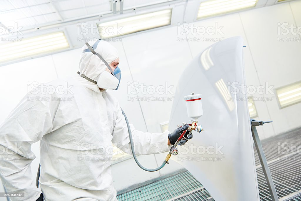 repairman painter in chamber painting automobile car bonnet stock photo