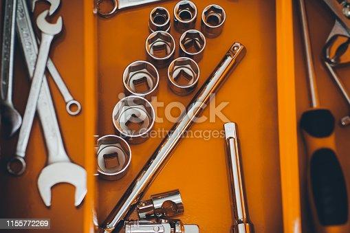 1155772265 istock photo repairman red toolbox mechanic wrench kit 1155772269